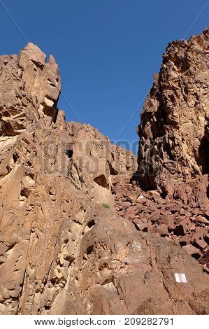 Scenic trail in red rocks of Eilat Mountains Israel.