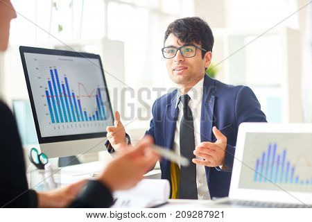 Businessman explaining his ideas or new financial strategy to colleague at meeting