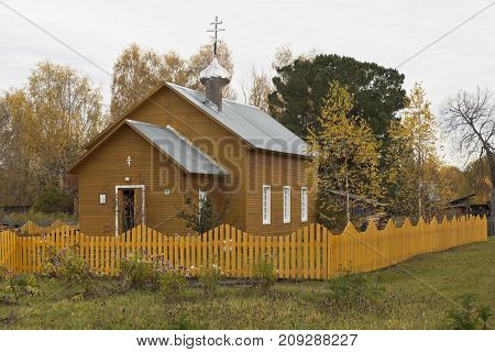 Spassky Pogost, Tarnogsky District, Vologda Region, Russia - October 9, 2017: Autumn landscape with a village church. Church of the Transfiguration of the Lord in Spassky Pogost