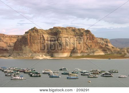 View Of Lake Powell And Boats During Sunset