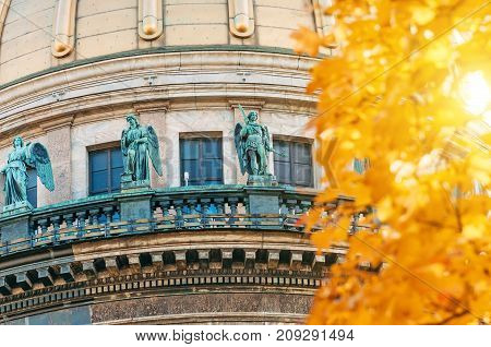 View Of The Ancient Statues Of Stucco And The Dome Of St. Isaac's Cathedral Petersburg Autumn Maple