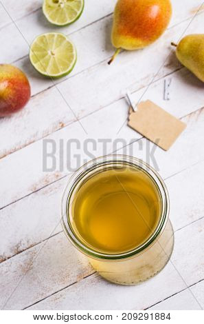 Home made fruit vinegar on a light wooden background. Selective focus.