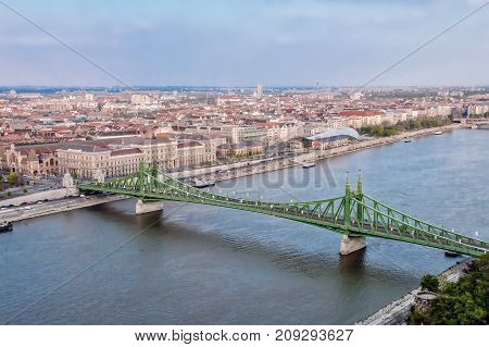 Budapest famous green bridge over Danube river in the evening