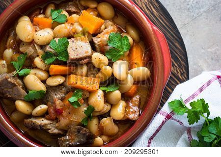 Beef stew with beans and vegetables. Chili con carne. Top view with copy space. Close up.