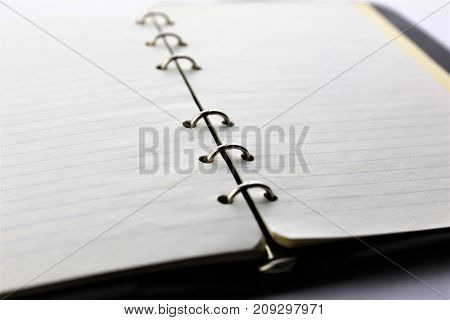 An image of a ring binder - ring book