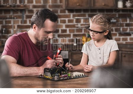 Father And Daughter Brazing At Home