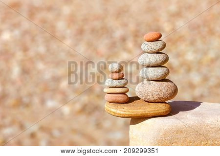 Rock zen pyramid of white red and yellow stones. Concept of balance harmony and meditation. Soft focus selective focus