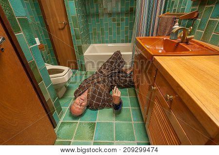 A senior man fell on a bathroom floor