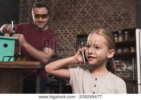 Daughter Talking By Smartphone