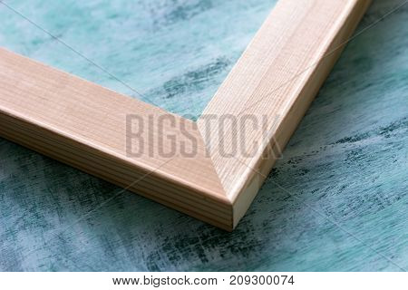 The angle of the subframe on a blue background. Wooden stretcher bars.