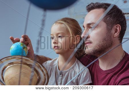 Father Showing Daughter Model Of Earth
