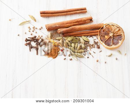 Spices For Making Mulled Wine On White Wooden Table