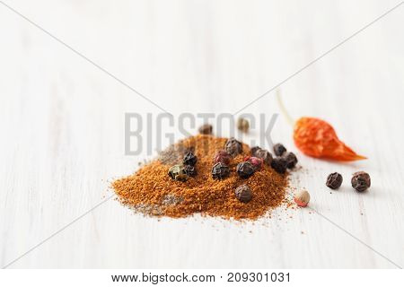 Red, Black Pepper And Bell Pepper, Dry Chilli Pod On White Wooden Table