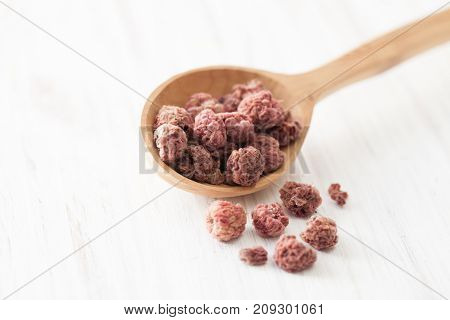 Dried Fruits Raspberries In Wooden Spoon On White Wooden Table