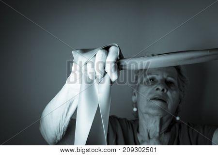 Rehabilitation exercises for older women with elastic band