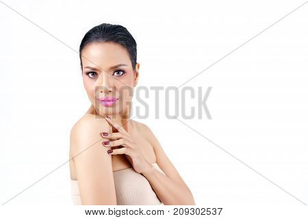 Close up beautiful middle age Asian woman's face hands touching her shoulder isolated on white background beauty concept