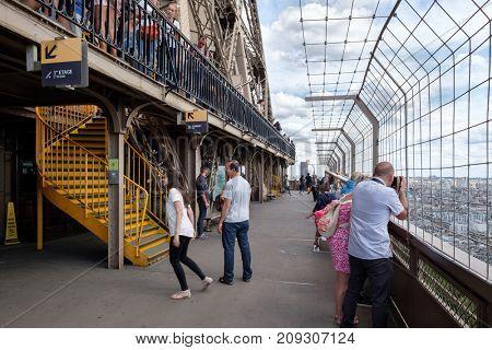 PARIS,FRANCE - JULY 30,2017 : Tourists at the Eiffel Tower in Paris