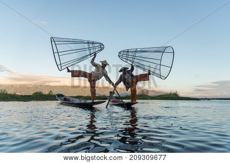 Intha fishermen working in the morning.Inle lake Myanmar