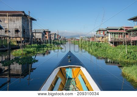 Tradition boat transportation at Inle lake floating garden in Intha viillageInleMyanmar