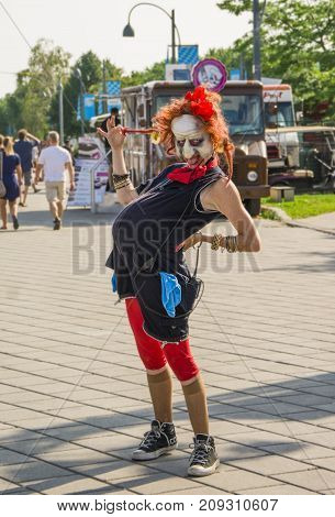 MONTREAL CANADA - AUGUST 10 2014: Pregnant woman in a mask of a witch posing in the street of Montreal