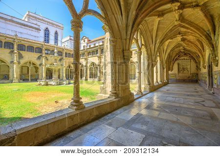 Colonnade of cloister of Santa Cruz Monastery and Church. The Church of Santa Cruz is one of the most fascinating religious buildings of Coimbra in Portugal.