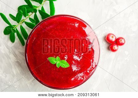 Red Cranberry Sauce In Sauce Pan For Thanksgiving Day Over Grey Background