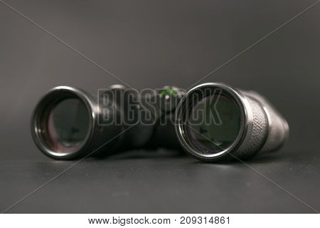 Binoculars With Large Magnification On A Monophonic Background.