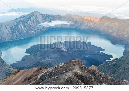 Scenery of Mount Rinjani active volcano and crater lake from the summit at sunrise Lombok - Indonesia.