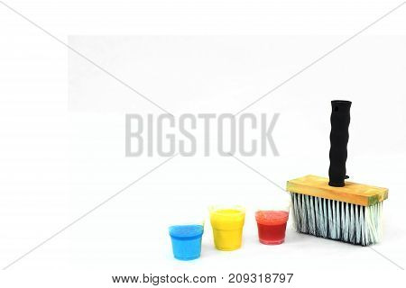 Big paintbrush and blue, yellow and red stains - right mock up