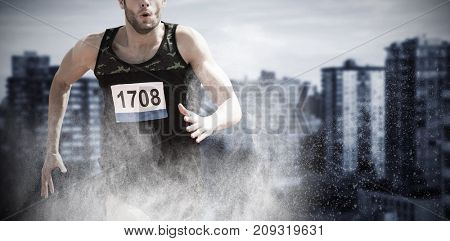 Fit man running against white background against high angle view of modern buildings city