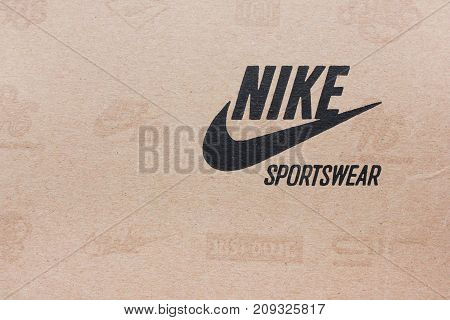 MOSCOW, RUSSIA - OCTOBER 9, 2017: Nike Sportswear Shoe Box with Company Logo.  Nike is an American corporation, world's largest supplier of athletic shoes and apparel, selling equipment and accessories.