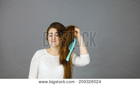 Happy Woman Brushing Her Hair