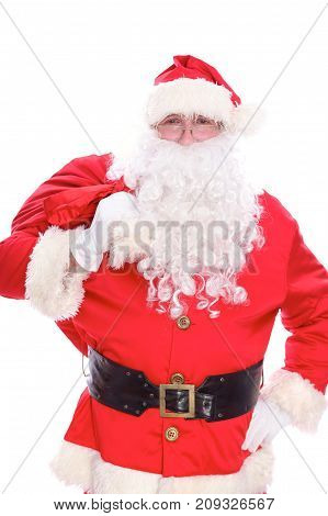 Kind Santa Claus carrying big bag, isolated on white background.