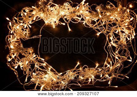 Abstract sparkling lights glittering in a circle shape with yellow bokeh. Defocused Xmas concept