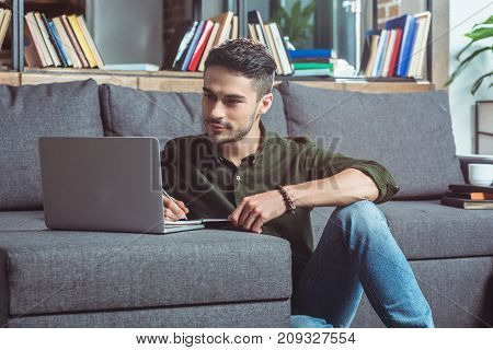 Man With Laptop And Notebook