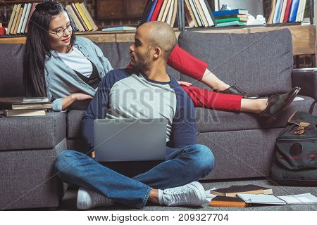 Multiethnic Students With Laptop And Books