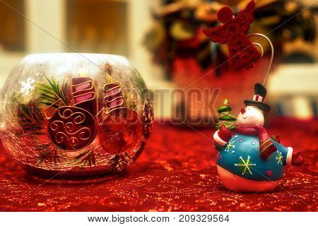 Christmas decorations carry candles on the table