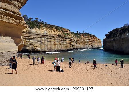 Tourists Visiting The Great Ocean Road In Melbourne, Australia