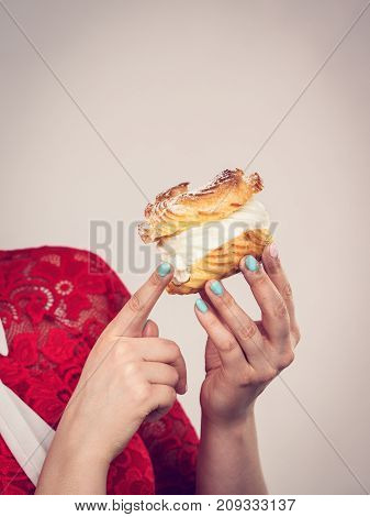 Woman Holding Cream Baked Dessert