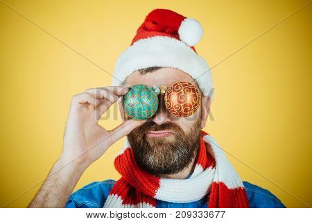 Christmas Man Cover Eyes With Xmas Balls On Yellow Background