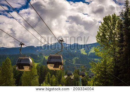 WHISTLER, BRITISH COLUMBIA, CANADA - JULY 2, 2017 : Cableway gondola in Whistler Village. Whistler is a canadian resort town visited by over 2 million people annually.