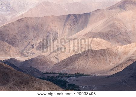 Landscape image of mountains and valley village in Ladakh India