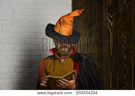 Halloween Man In Witch Hat And Cloak