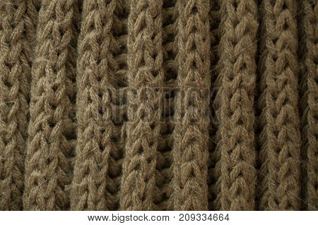 Knitted fabric texture and background. Green knitted fabric texture. Close up view of knitted fibers texture. Abstract texture and background for graphic design. Macro view of green fibers.