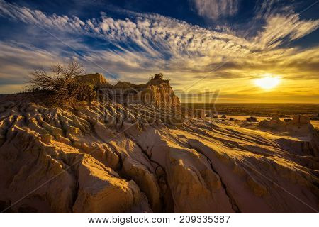 Dramatic sunset over Walls of China in Mungo National Park, New South Wales, Australia