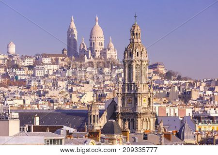 Aerial view of Sacre-Coeur Basilica or Basilica of the Sacred Heart of Jesus at the butte Montmartre and Saint Trinity church in the morning, Paris, France