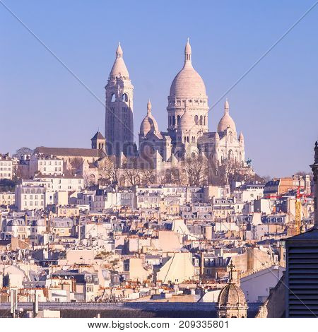 Aerial view of Sacre-Coeur Basilica or Basilica of the Sacred Heart of Jesus at the butte Montmartre in the morning, Paris, France