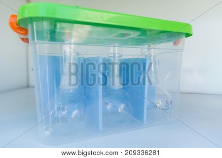 laboratory test tube three glass flasks with green covers
