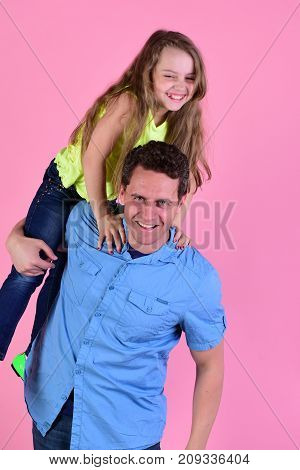 Daughter And Father Hug Each Other. Schoolgirl On Dads Shoulders.