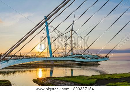 Bridge at sunset in Gaomei Wetlands scenic area